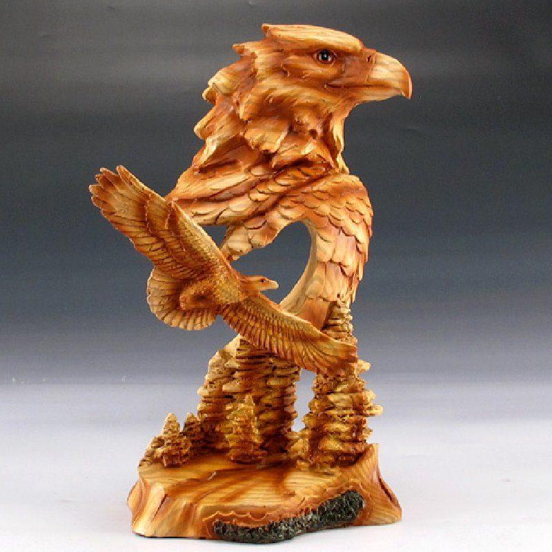 Beautiful carved Eagle figurine featuring a bald eagle head & smaller eagle soaring majestically above the trees.