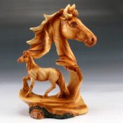Beautiful carved horse figurine featuring a prominent horse head and trotting baby horse.