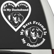 The Circle & Heart Shaped My Best Friend Is My Dachshund dog decals are shown together on a car window.