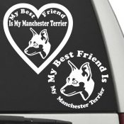The Circle & Heart Shaped My Best Friend Is My Manchester Terrier dog decals are shown together on a car window.